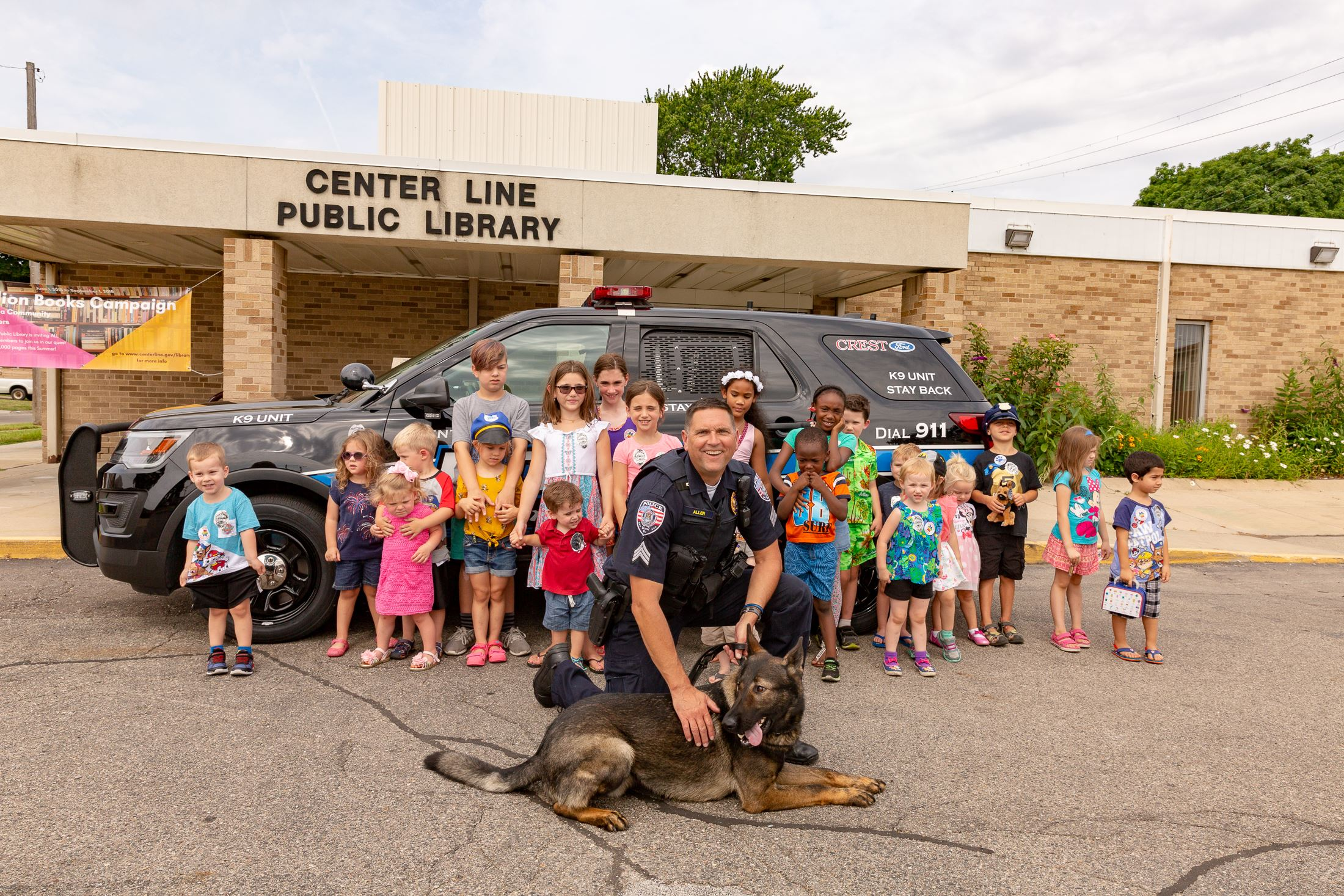 Officers Dave Allen and K-9 Murphy in front of Center Line Library.